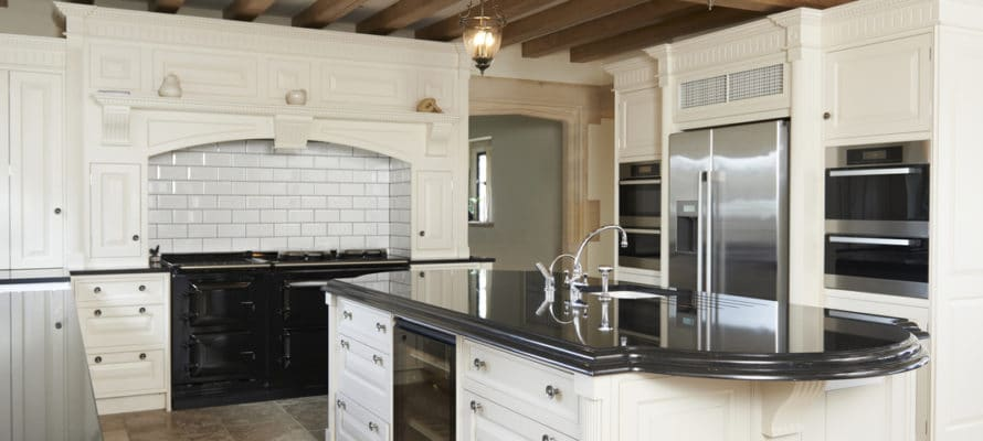 Utah home builder Luxury Fitted Kitchen In House With Beamed Ceiling
