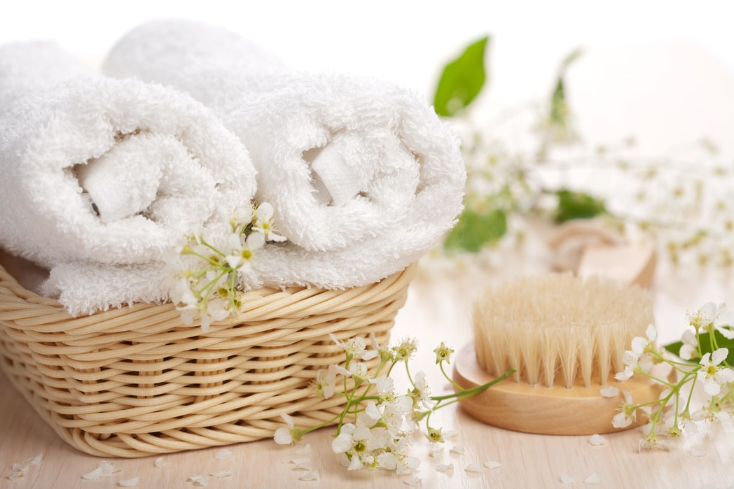 Utah home builder towels in a basket with brush