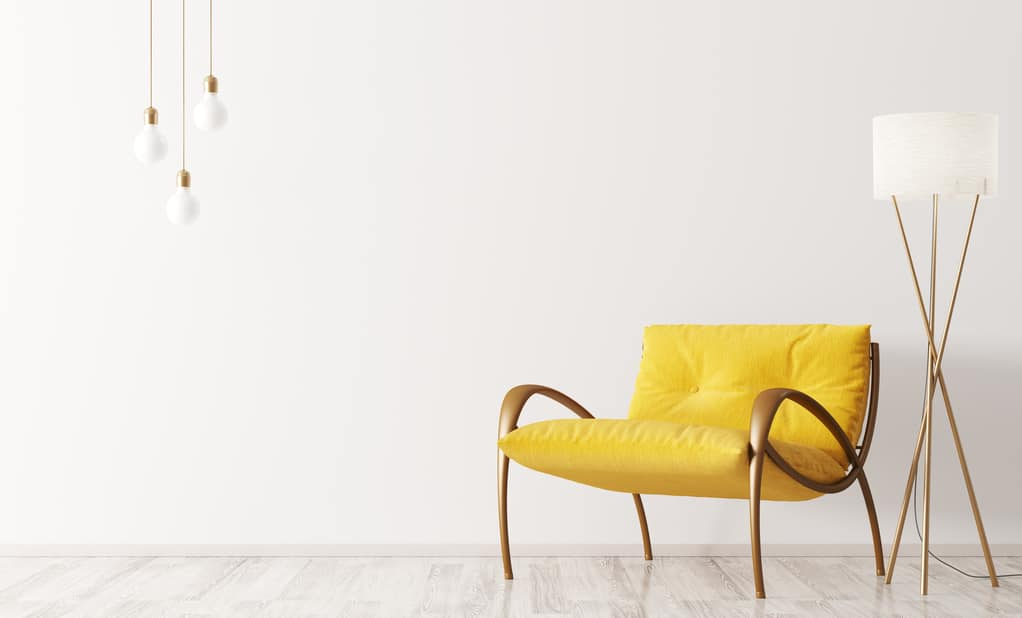 Utah home builder interior with yellow armchair and lamp