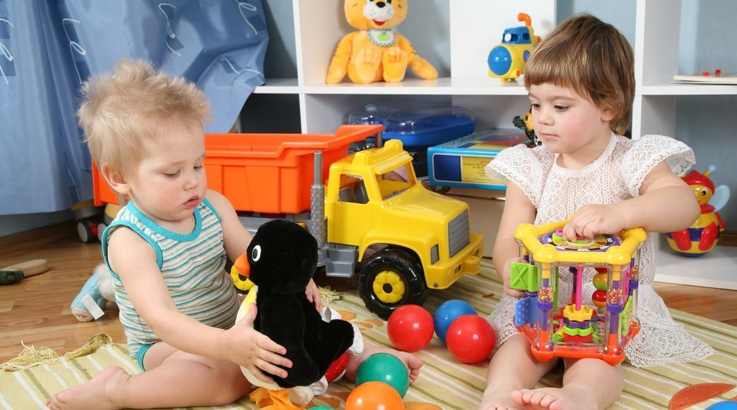 Children playing with toys in playroom